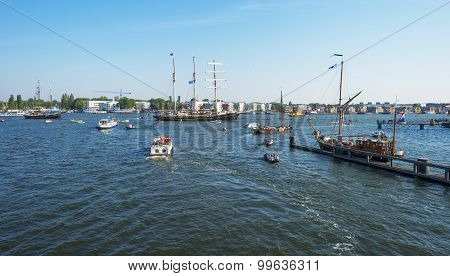 Ships sailing and mooring in the harbor of Amsterdam