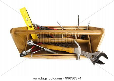 Wooden toolbox with tools isolated on white