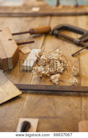 Wood working or a carpentry. Clamps and wood shavings on a work piece.