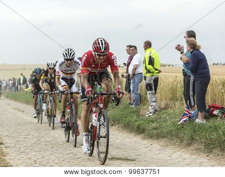 Group Of Cyclists On A Cobblestone Road - Tour De France 2015
