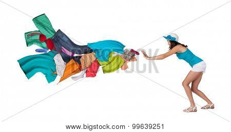 Young woman refusing colored clothing. Concept of washing laundry. Isolated on white background