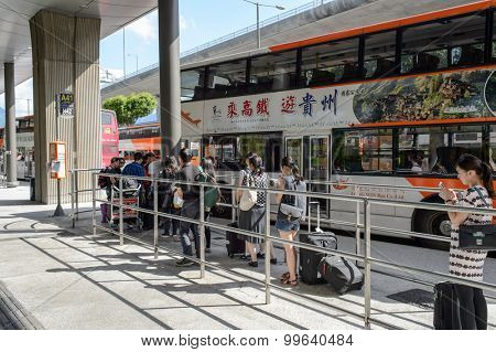 HONG KONG - JUNE 04, 2015: people boarding A41 in airport. Hong Kong International Airport is the main airport in Hong Kong. It is located on the island of Chek Lap Kok