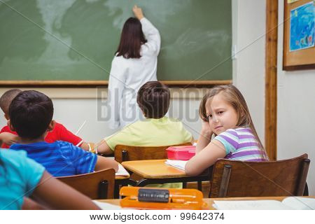 Bored student looking away from board at the elementary school
