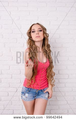 Alluring Girl With  Very Long Hair Standing On White Background