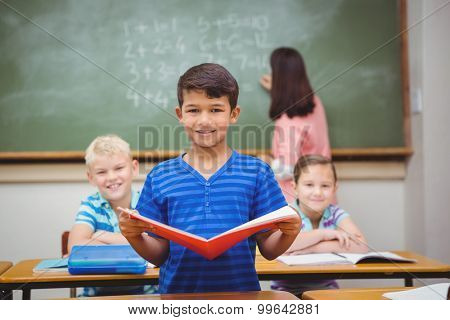 Student reading from a book at the elementary school