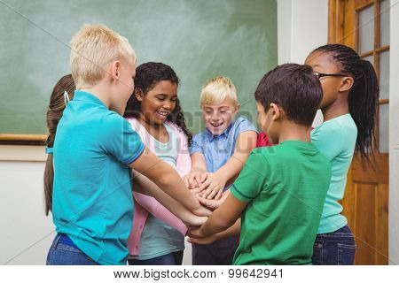 Students putting hands together at the elementary school