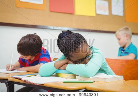 Student asleep on a desk at the elementary school