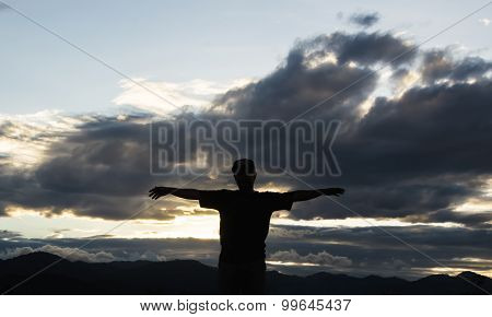 Man Silhouette, moments Of The Man's Joy. On The Nature Sunset