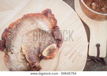Pork Steak On Wooden Plate