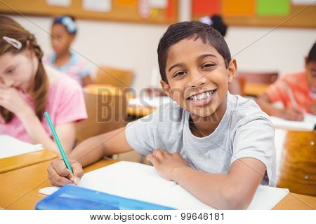 Pupil working at his desk at the elementary school
