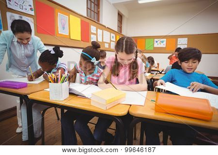 Pupils working at their desks in class at the elementary school