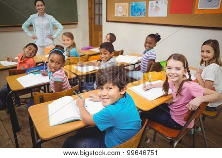 Pupils smiling at camera during class at the elementary school