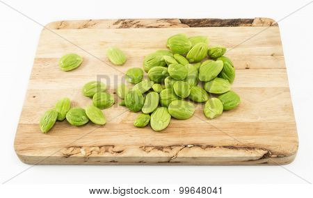 Parkia Speciosa Seed On Wooden Cutting Board Isolated On White Background