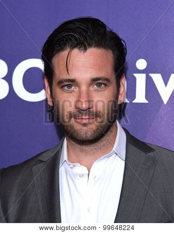 LOS ANGELES - AUG 13:  Colin Donnell arrives to the Summer 2015 TCA's - NBCUniversal  on August 13, 2015 in Hollywood, CA