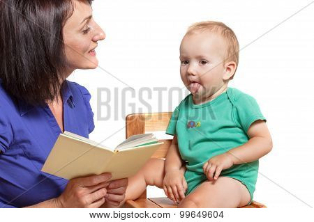 Mother Reading A Book To His Mischievous Kid. Isolated On White