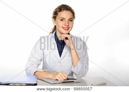 Medical Doctor In A White Coat Smile And Fills The History Of The Disease