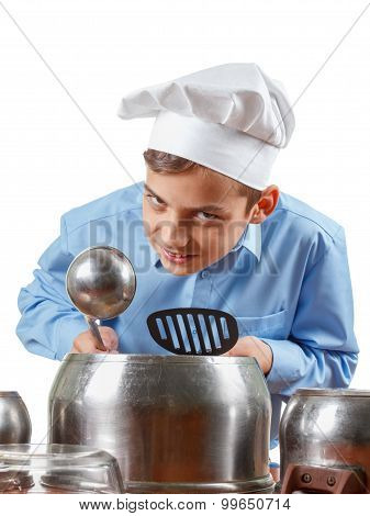 Young Cheerful Teenager Humor In A Chef's Hat. He Plays The Drums, Pots. Isolated Studio