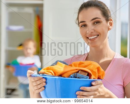 family with a basin full of laundry