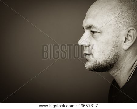 Profile portrait of bald man with copyspace. Black and white photo