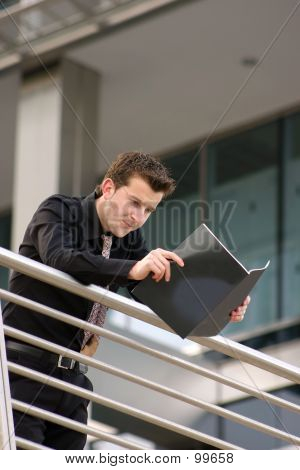 Business Man Reading Manual - Arisv