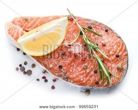 Salmon steak on white background.