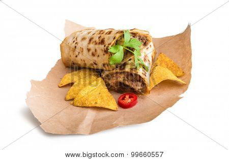 burrito with chips on parchment isolated on a white background