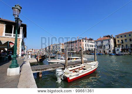 VENICE, ITALY - SEPTEMBER 2014 : A pier at the Venice's Pescheria  in Venice, Italy on September 15, 2014. Pescheria is a fish market at Rialto, a commercial center of Venice.