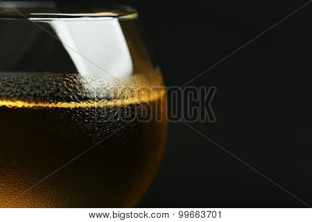 Glass of wine on dark background