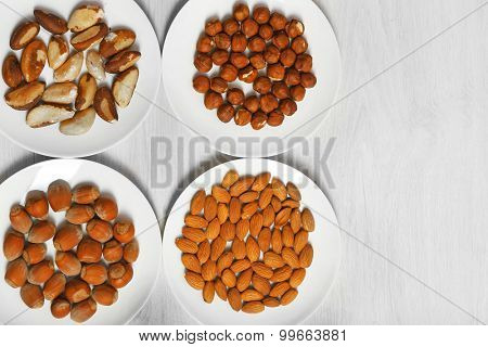 Collection of nuts on wooden background