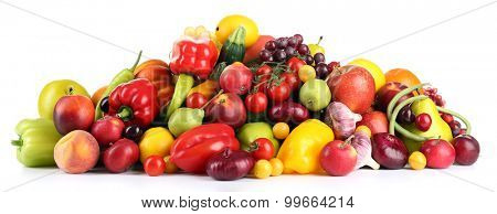 Heap of fresh fruits and vegetables  isolated on white