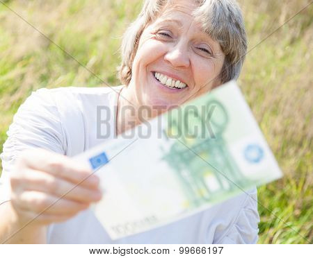 Old age woman hands over hundred euro