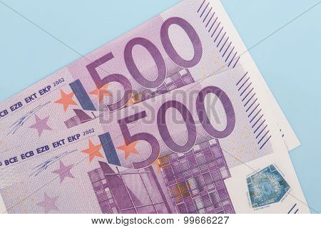 Two 500 euro notes on light blue backgrond