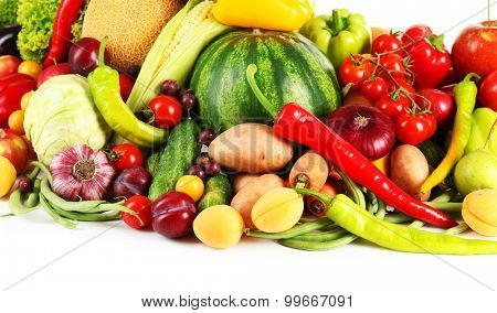 Composition with fresh fruits and vegetables on white background