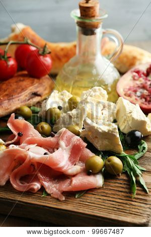Ingredients of Mediterranean cuisine, on wooden background