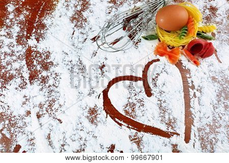 Row pasta with egg on flour background