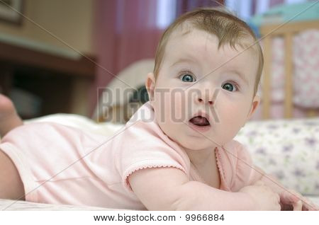 Closeup Portrait Of Adorable Baby Girl Looking At Camera