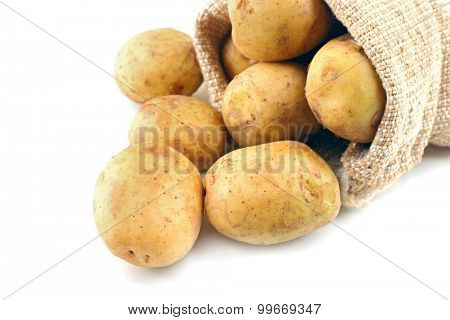 Young potatoes in sackcloth bag isolated on white