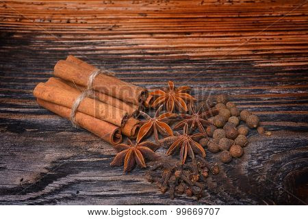 Spices Lying On A Wooden Surface