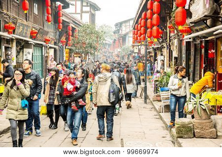 CHONGQING, CHINA - JAN 17: Unidentified tourists are shopping at Ciqikou Ancient Town on January  17, 2014 , Chongqing, China.