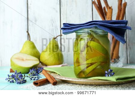 Pear juice with fresh fruits on table close up