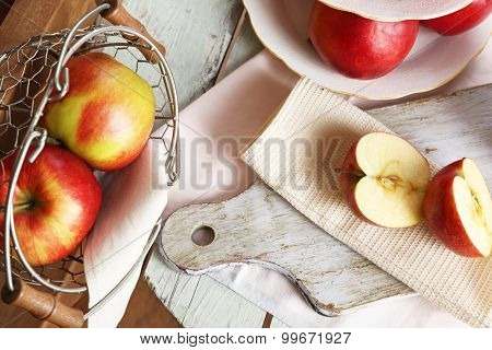 Tasty ripe apples on table close up