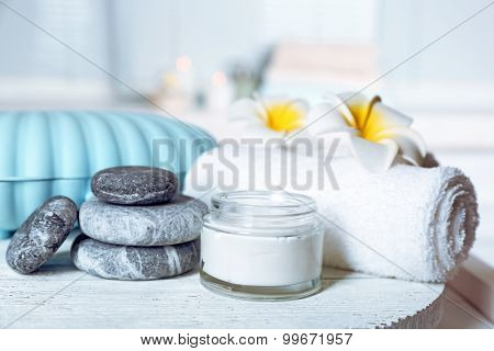 Spa stones and spa treatments on light background