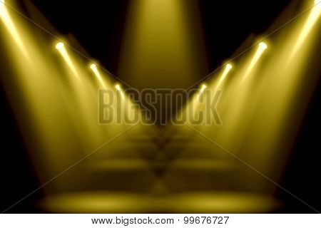 Abstract gold lighting flare on the floor center stage.