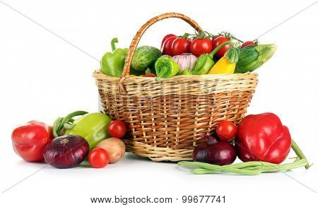 Heap of fresh fruits and vegetables  in basket isolated on white