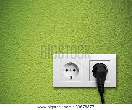 White Electric Outlet Mounted On Green Wall