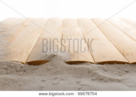 Sand with wooden planks, closeup