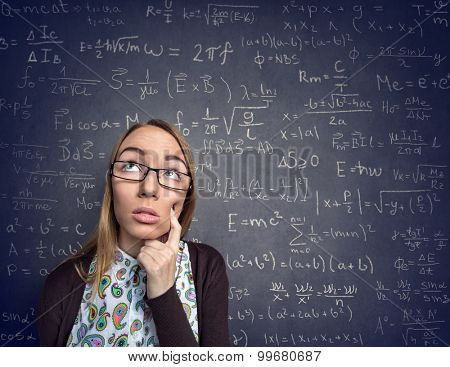 Think nerd female over wall with formulas