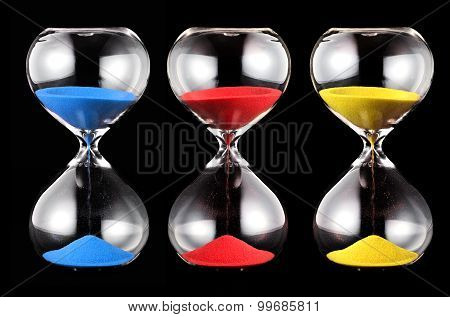 Three Hourglasses With Colorful Sand