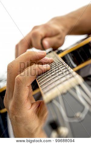 Closeup Of Male Guitarist Playing Black Jazz Electric Guitar