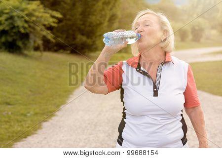 Healthy Senior Woman Drinking Bottled Water